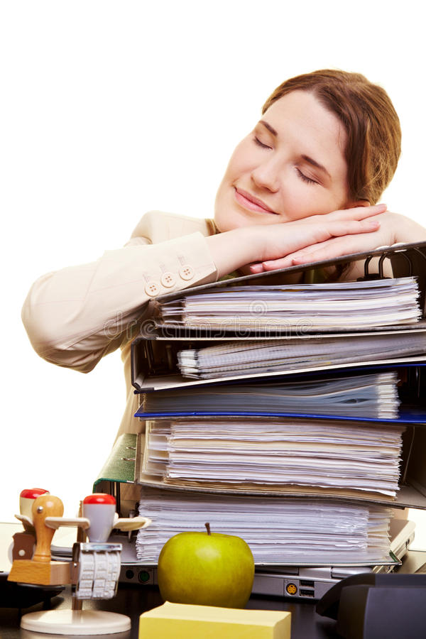 Businesswoman sleeping on files