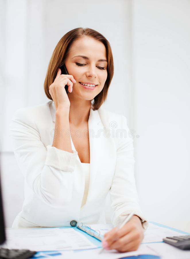 Download Businesswoman With Smartphone In Office Stock Photo - Image: 33877988