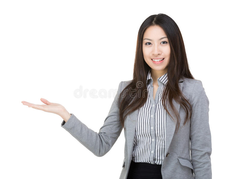 Businesswoman smile hold open palm stock image