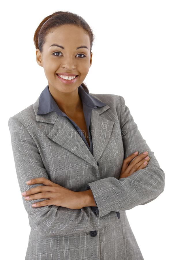 Businesswoman smiling. Portrait of smart businesswoman smiling with arms crossed royalty free stock photos