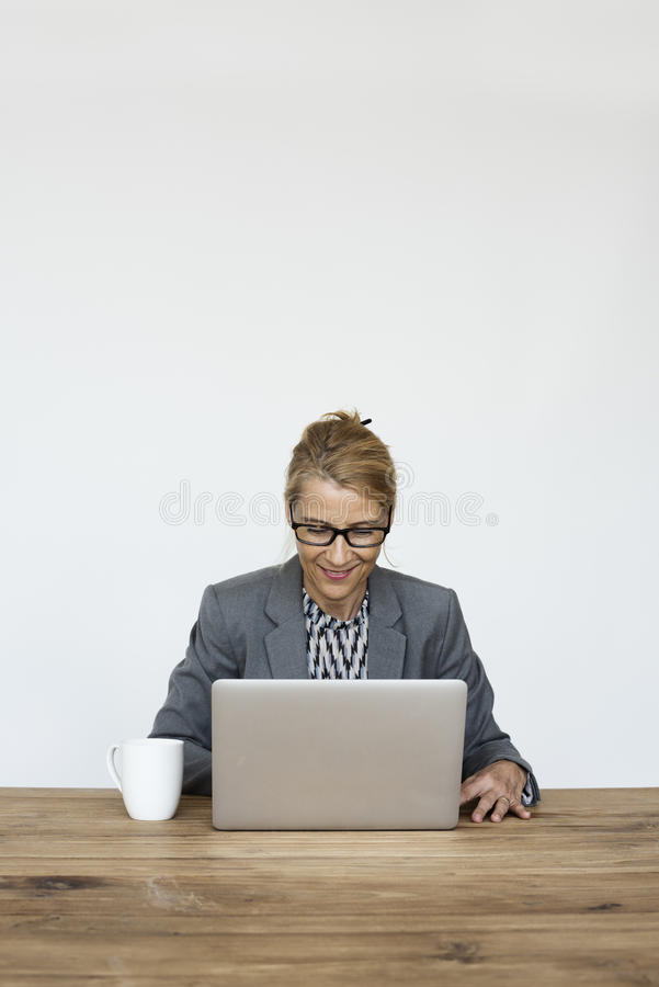 Businesswoman Smiling Happiness Working Laptop Studio Portrait royalty free stock photography