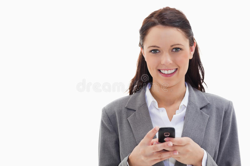 Download Businesswoman Smiling And Holding Her Mobile Stock Photo - Image: 23012068