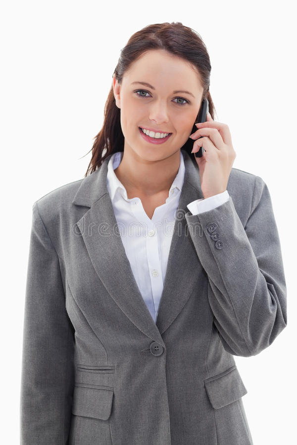 Download Businesswoman Smiling Over The Phone Stock Image - Image: 23012019
