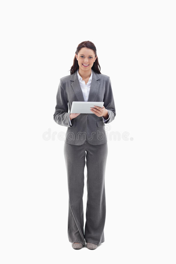 Businesswoman Smiling With A Touch Pad Royalty Free Stock Photo