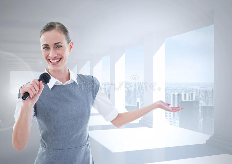 Businesswoman speaking on microphone royalty free stock photo