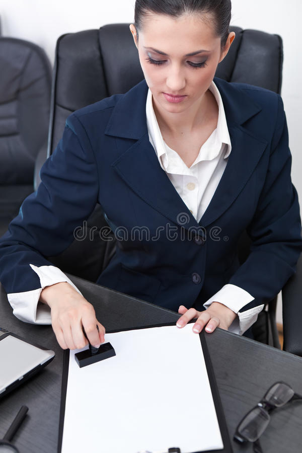 Free Businesswoman Stamping Documents Stock Photography - 19523142