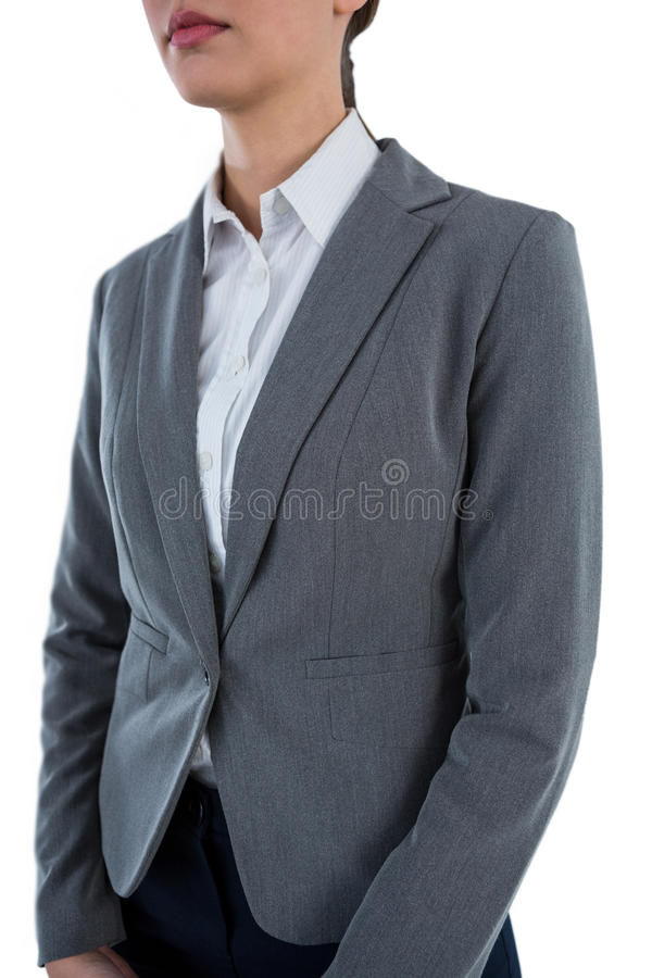Businesswoman standing against white background stock photography