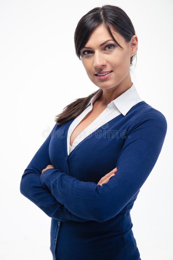 Businesswoman standing with arms folded. Smiling businesswoman standing with arms folded isolated on a white background and looking at camera royalty free stock images