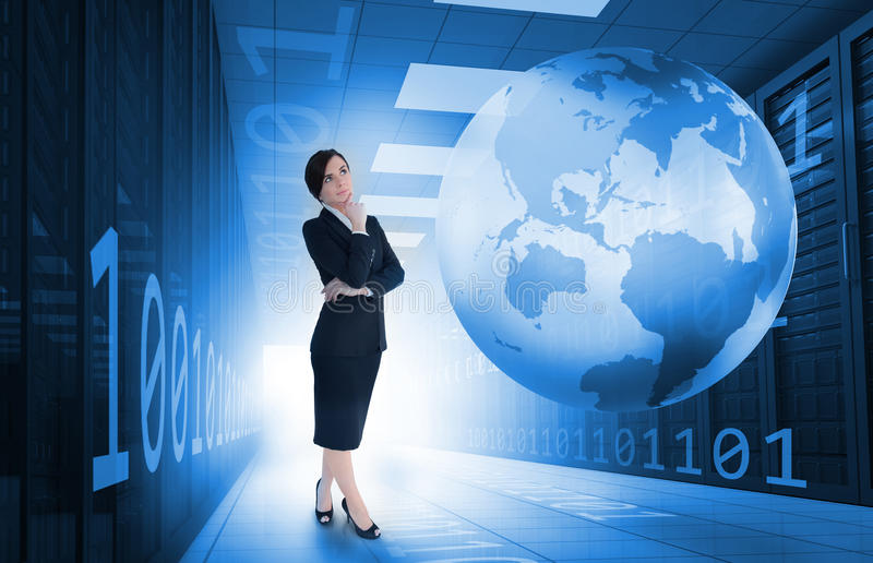 Businesswoman standing in data center with earth and binary code. Businesswoman standing and thinking in data center with earth and binary code graphics stock photo