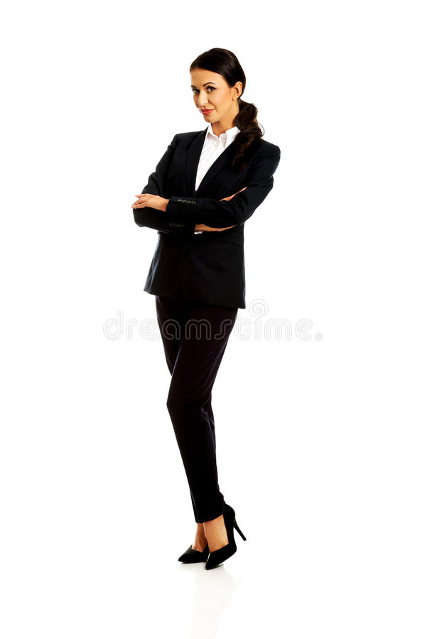 Businesswoman standing with folded arms. Confident businesswoman standing with folded arms royalty free stock images