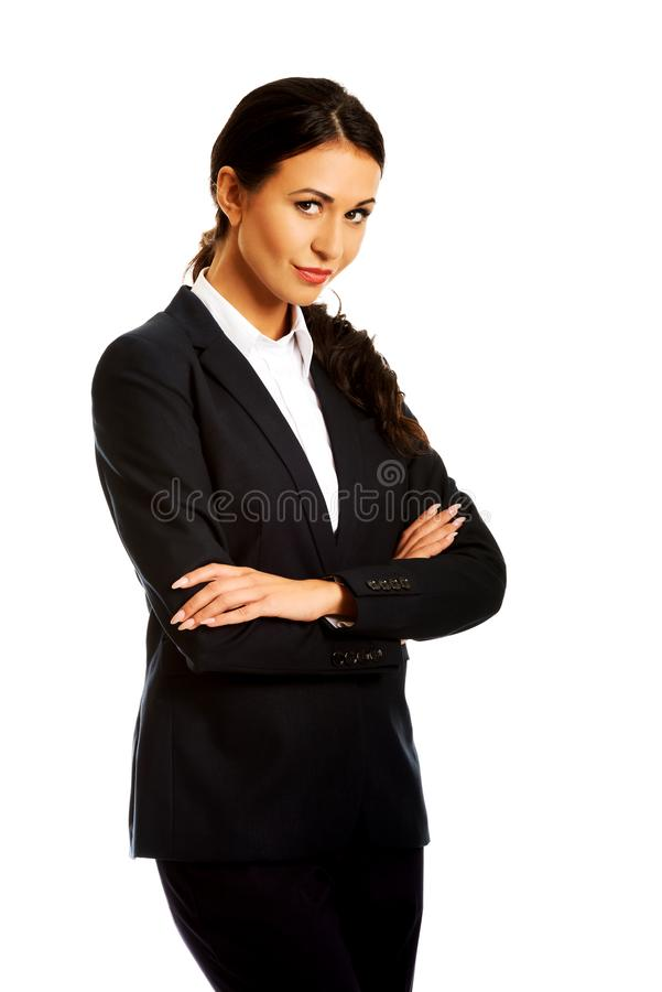 Businesswoman standing with folded arms. Confident businesswoman standing with folded arms royalty free stock image