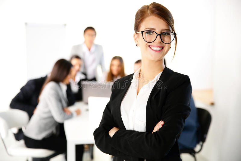 Businesswoman standing in front of a business meeting stock images