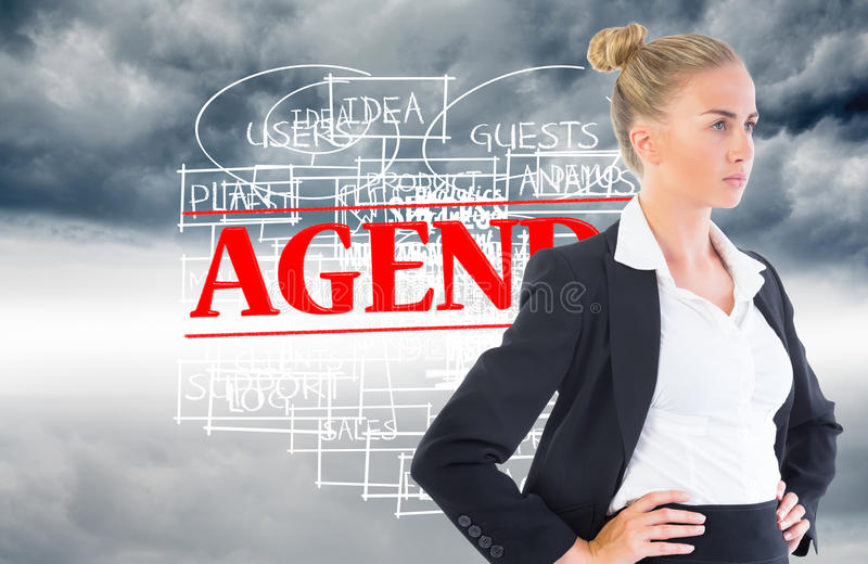Businesswoman standing with hands on hips. Composite image of blonde businesswoman standing with hands on hips royalty free stock photography