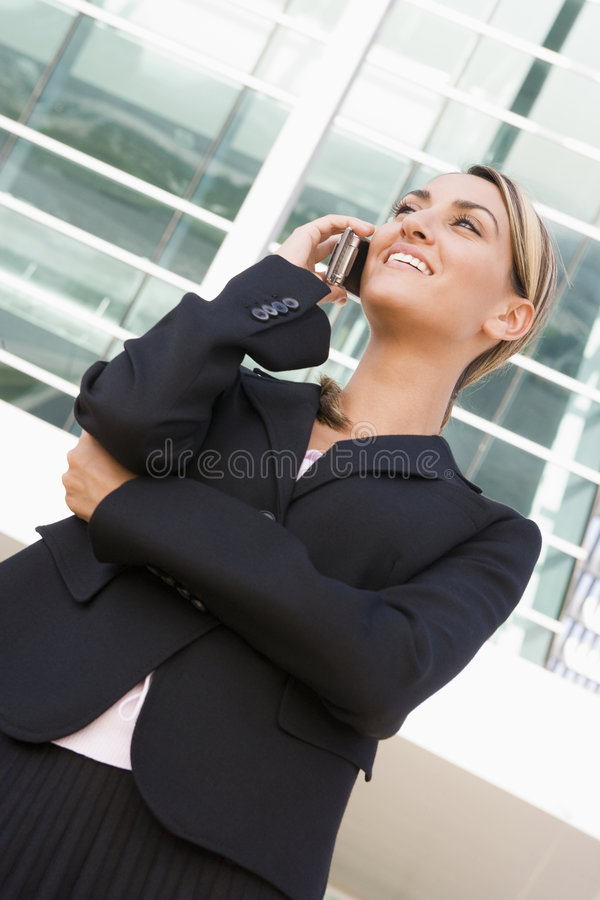 Free Businesswoman Standing Outdoors Using Mobile Phone Royalty Free Stock Photos - 5677828
