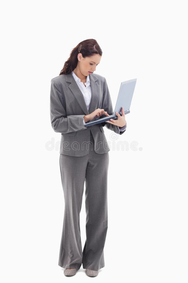 Download Businesswoman Standing And Typing On A Laptop Stock Photo - Image: 23011824