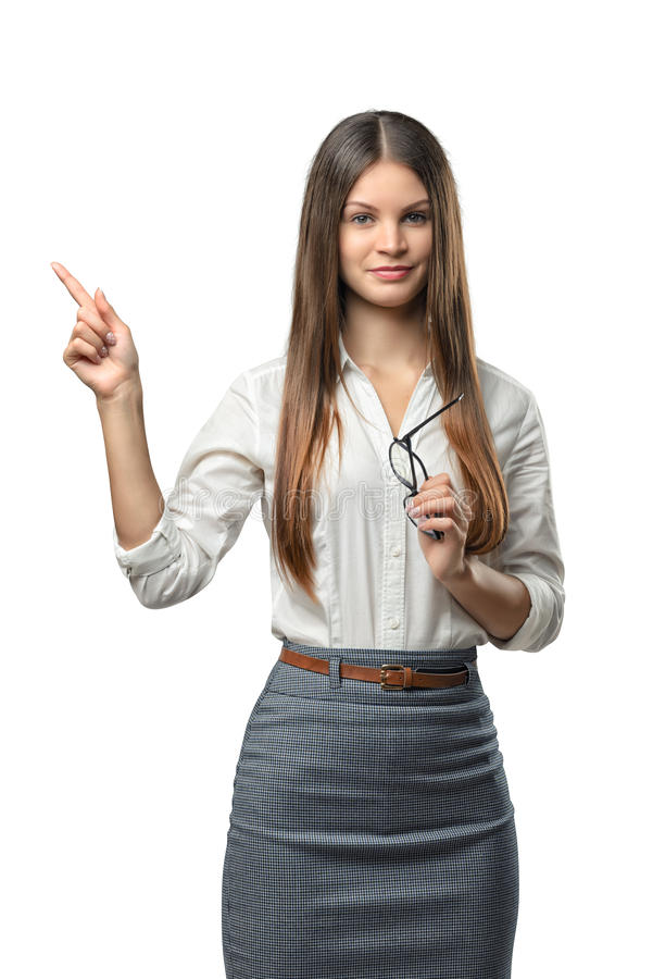 Businesswoman stands pointing somewhere royalty free stock photo