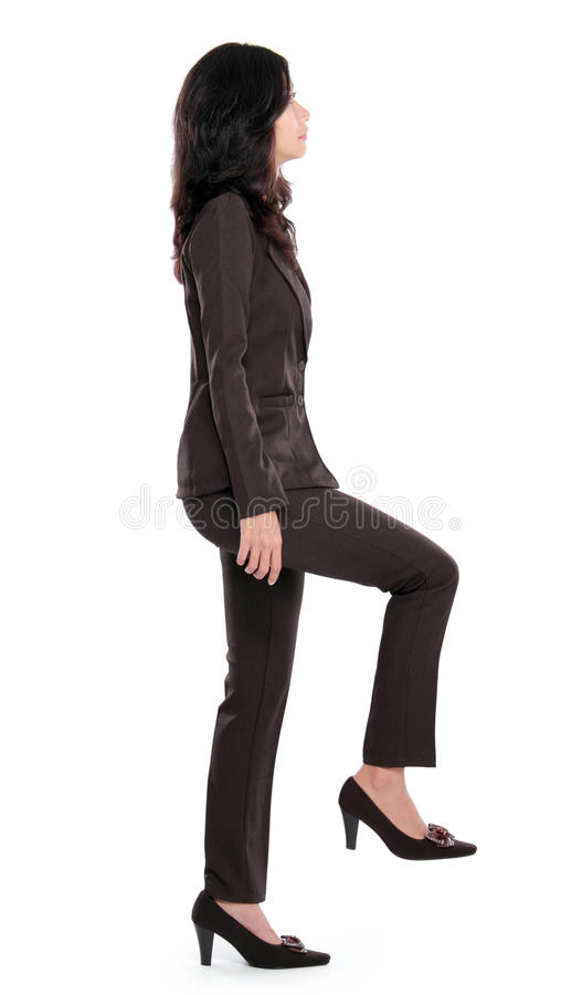 Businesswoman stepping up royalty free stock photography