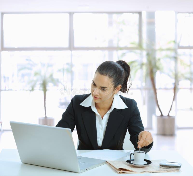 Free Businesswoman Stirring Coffee Royalty Free Stock Photography - 10914817