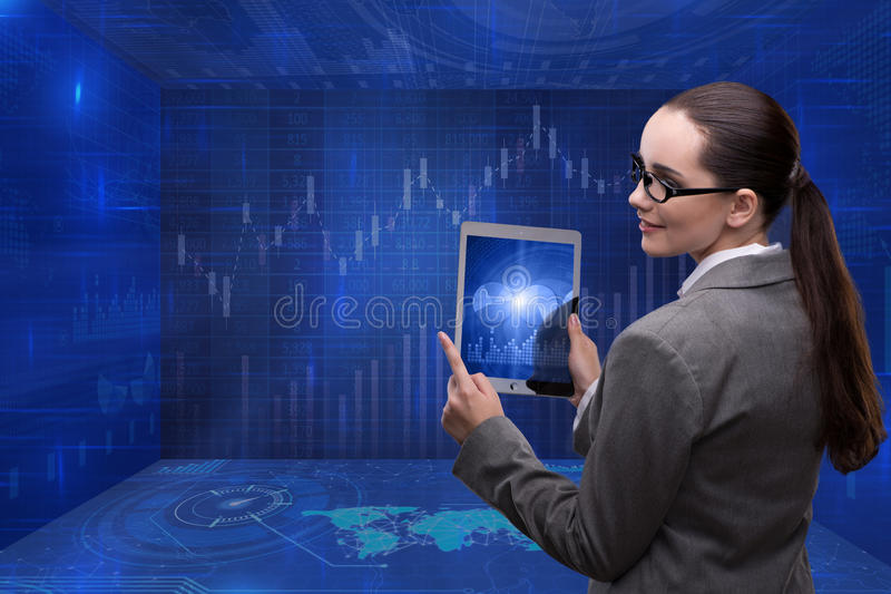 The businesswoman in stock exchange trading concept stock images