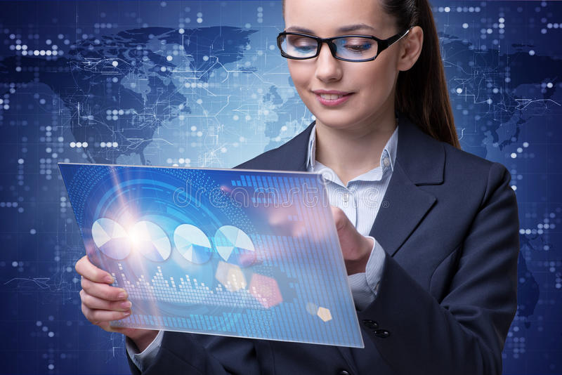 The businesswoman in stock exchange trading concept. Businesswoman in stock exchange trading concept stock image