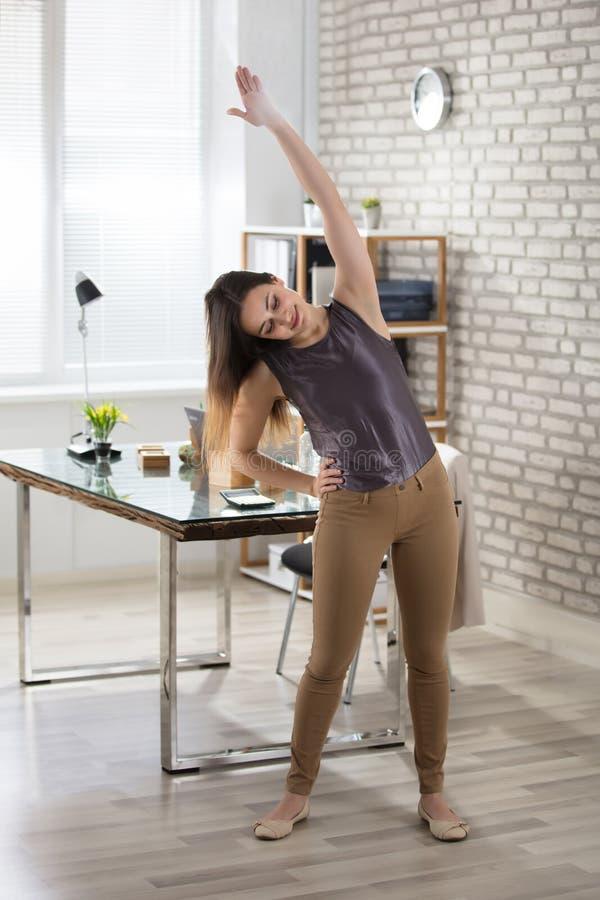 Free Businesswoman Stretching Stock Image - 103317651
