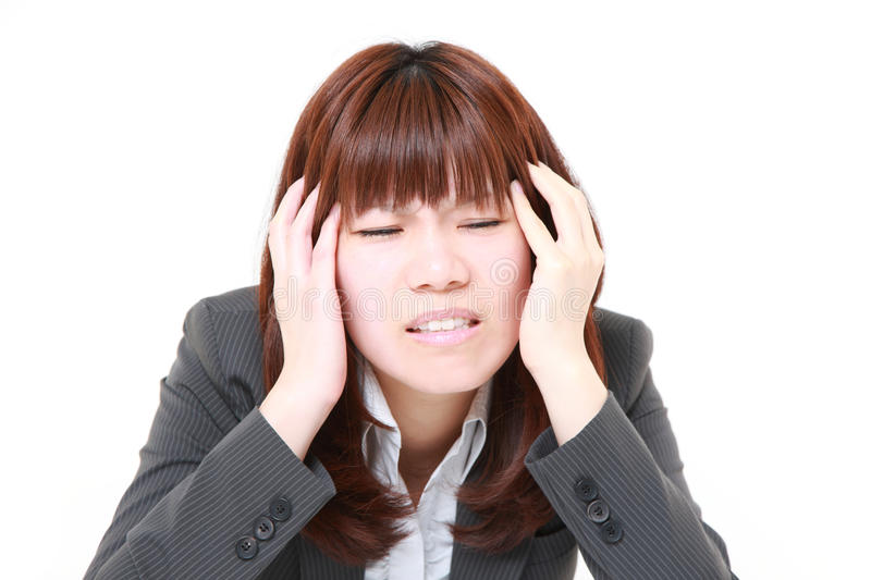 Businesswoman suffers from headache royalty free stock photo