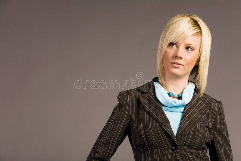 Businesswoman in suit. Young businesswoman in dark suit royalty free stock photo