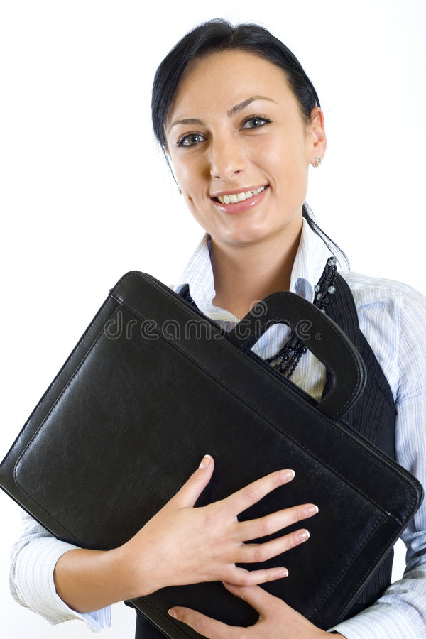 Businesswoman in a suit holds a briefcase stock photos