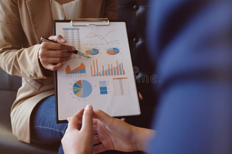 Businesswoman in suit making presentation explaining charts. and royalty free stock image