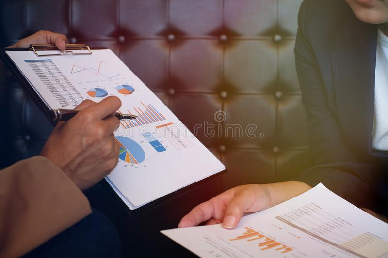 Businesswoman in suit making presentation explaining charts. and royalty free stock photo