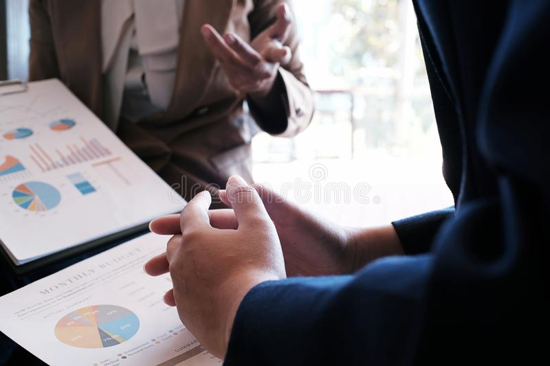 Businesswoman in suit making presentation explaining charts. and stock photo