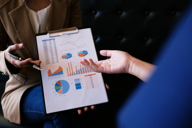 Businesswoman in suit making presentation explaining charts. and stock photography