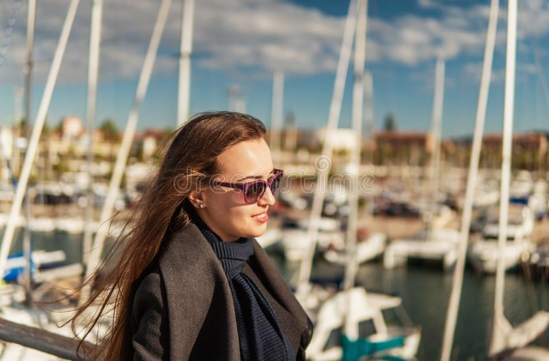 Businesswoman in sunglasses walking with a lot of yachts stock image