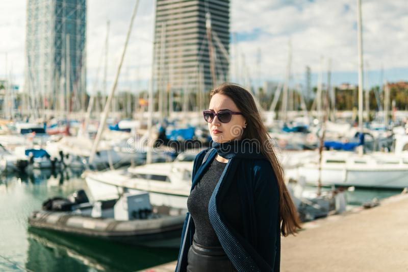 Businesswoman in sunglasses walking with a lot of yachts royalty free stock photos