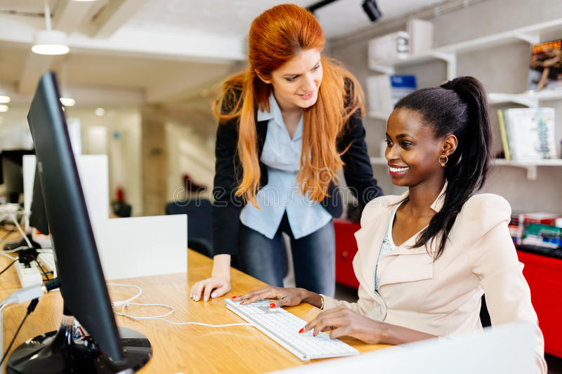 Businesswoman supervising employee. In modern office royalty free stock photos