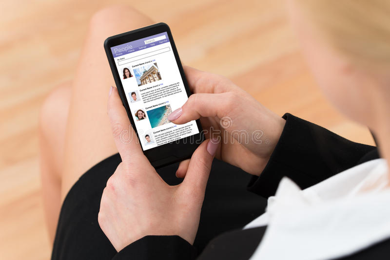 Businesswoman Surfing Social Networking Site stock photos
