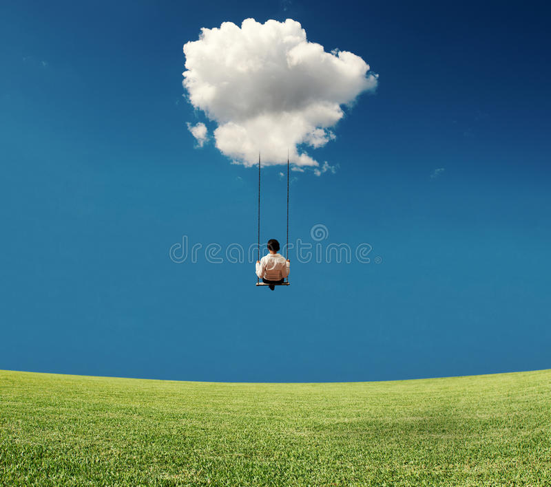 Businesswoman on a swing royalty free stock images