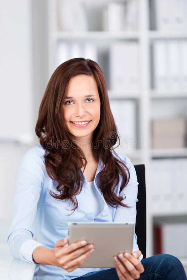 Businesswoman with a tablet-pc stock images