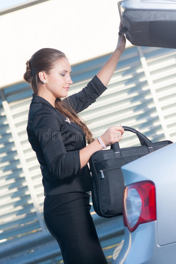 Download Businesswoman Takes Bag Out From The Car Stock Images - Image: 33164514