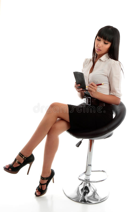 Businesswoman taking dictation or notes royalty free stock photo