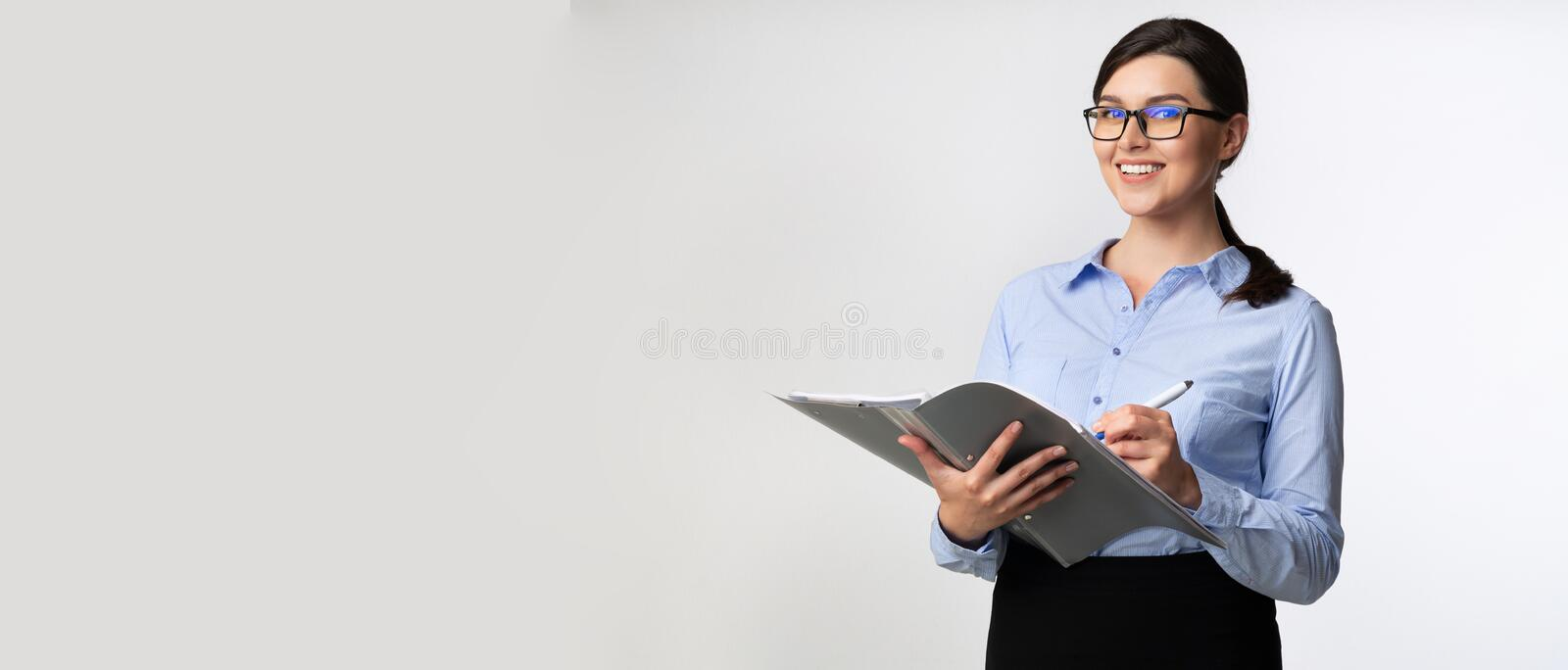 Businesswoman Taking Notes Holding Folder Looking At Camera, Panorama. Confident Businesswoman Taking Notes Holding Folder Looking At Camera On White Studio royalty free stock images