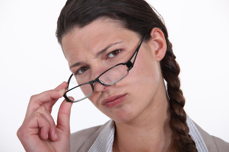 Businesswoman taking off her glasses. royalty free stock photography