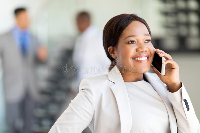 Businesswoman talking cell phone royalty free stock image