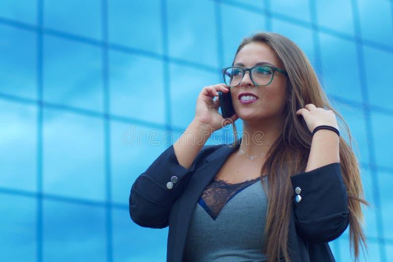 Businesswoman talking cellular phone success lady conversation outside building stock images
