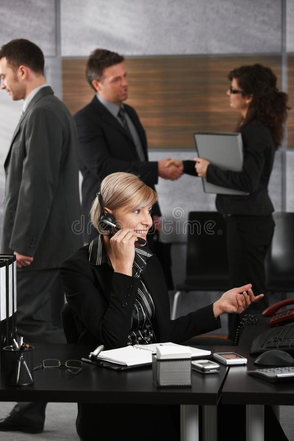 Businesswoman Talking On Headset Stock Images