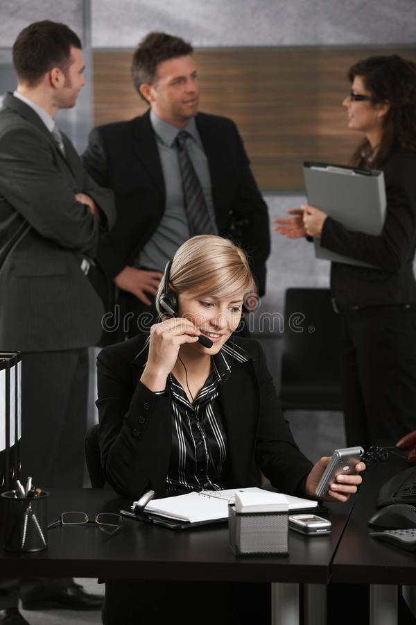 Download Businesswoman Talking On Headset Stock Photo - Image of businesspeople, color: 13314286