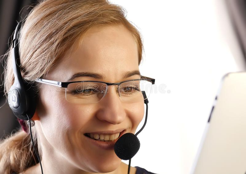Businesswoman talking on a headset in an office. customer service proffessional. stock images