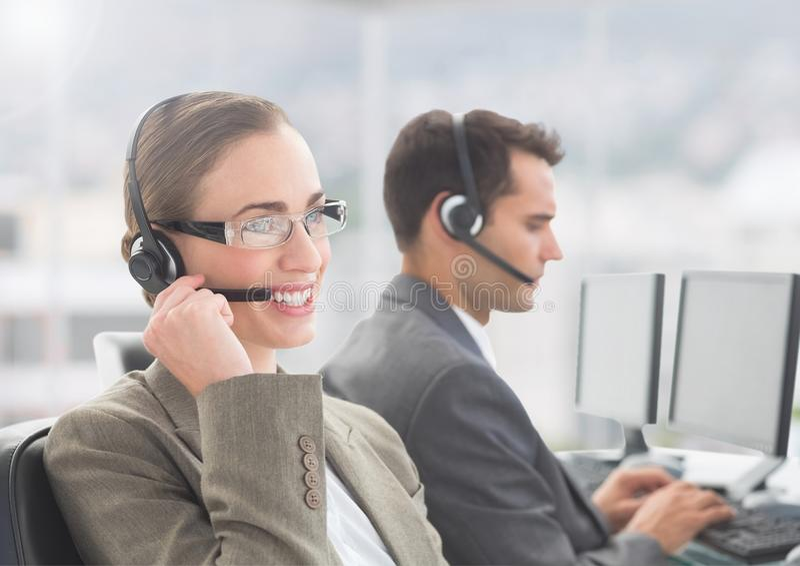Businesswoman talking on headset in office stock photo