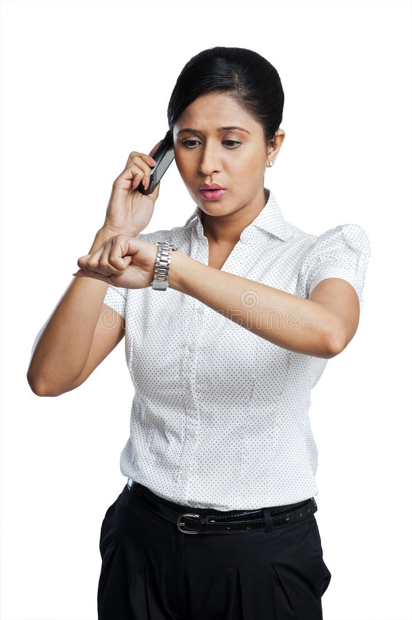 Businesswoman talking on a mobile phone royalty free stock image