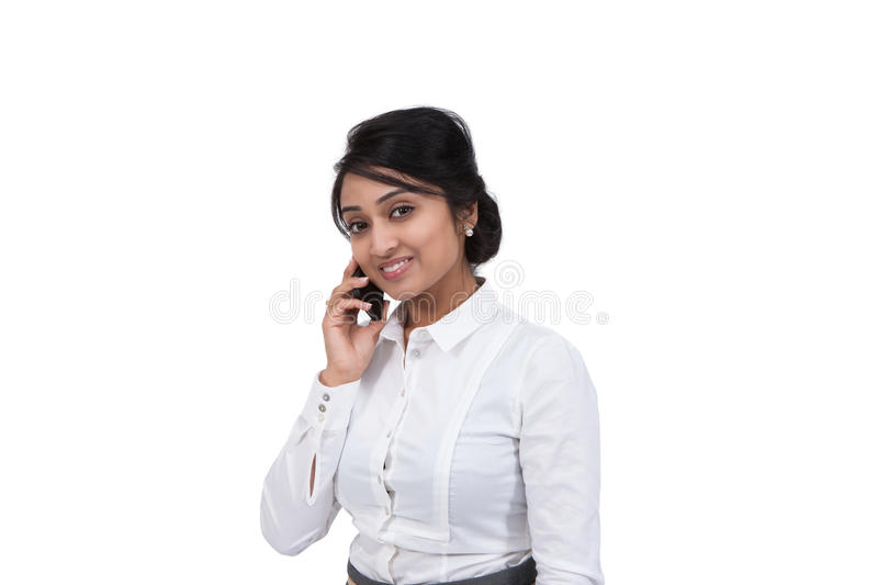 Businesswoman talking on mobile phone royalty free stock image